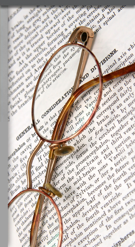 An image of glasses on a legal text